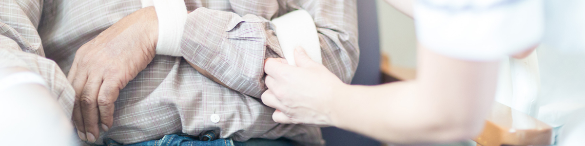 Nurse adjusting mans arm sling