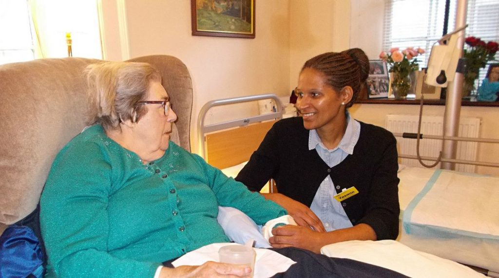 student nurse with older lady