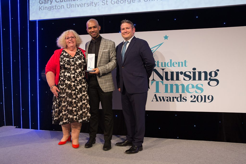 Nursing associate student Gary Cutmore collects his award for Most Inspirational Student Nurse of the Year